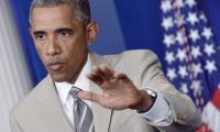 Obama indossa un abito beige e il web si scatena con le critiche e le battute ironiche
